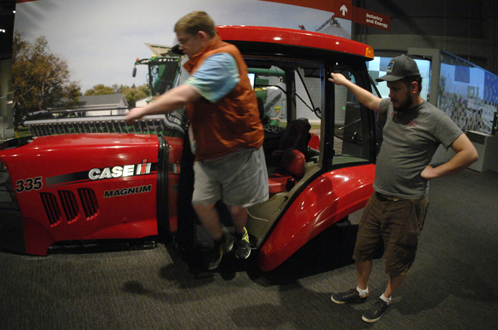 Eugene exits a tractor cab