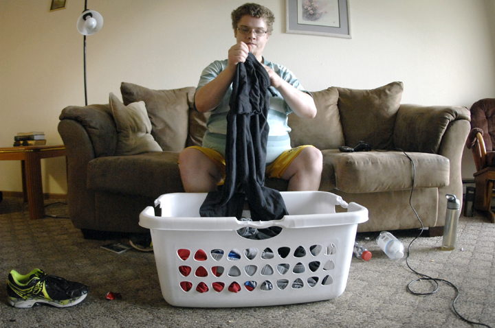 Eugene folds laundry